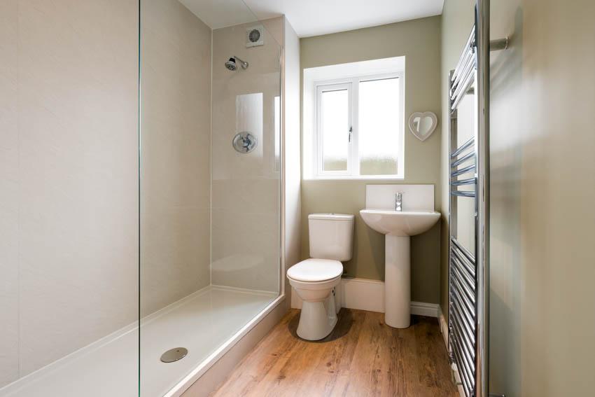 Bathroom with obscure glass window toilet sink glass door shower pan