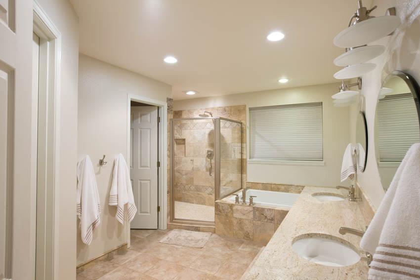 Bathroom with travertine floor countertop wall shower bathtub sink