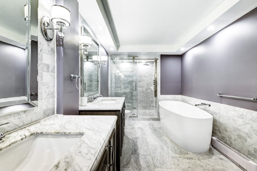 Bathroom with white marble and gray elements bathtub sink countertop