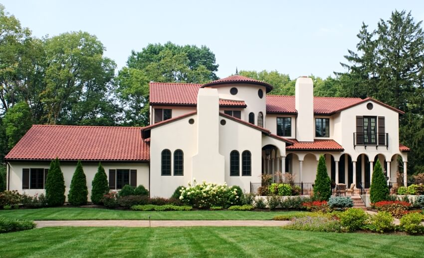 Beautiful house with big lawn and barrel tile roof
