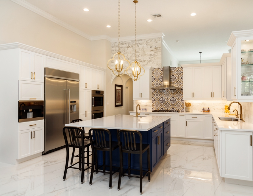 Beautiful kitchen interior with white marble floors center island with black chairs and appliances