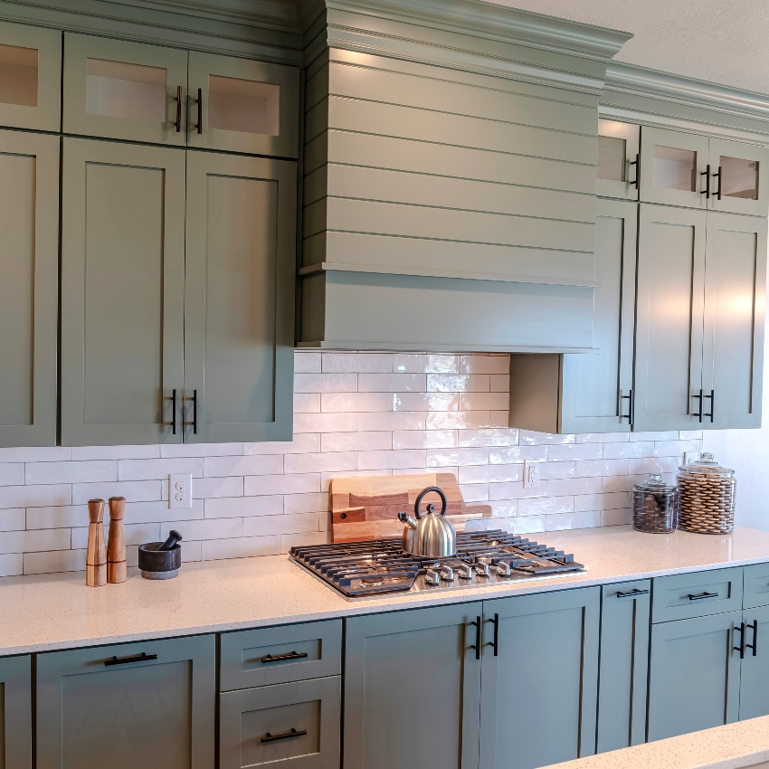 Beautiful matte army green kitchen double stacked cabinets and white quartz countertop