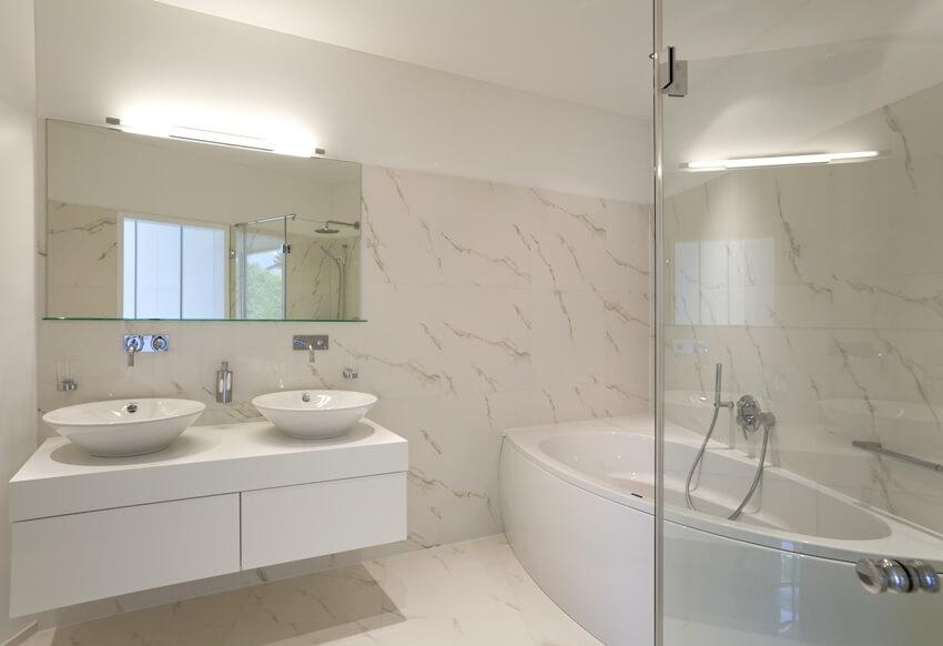 Beautiful white bathroom with full height quartz backsplash