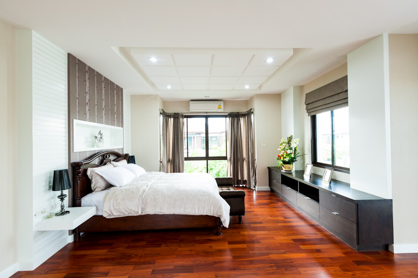 Bedroom with cherry wood floors white paint