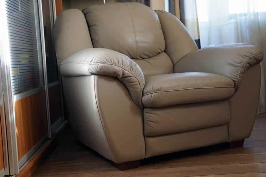 Beige reclining chair wooden floor