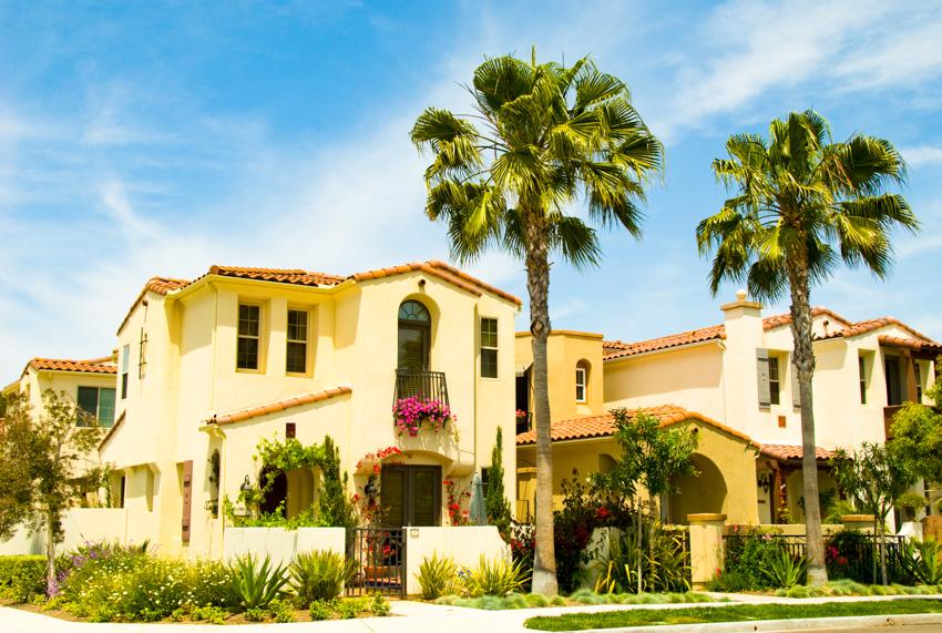 Big spanish style house palm trees