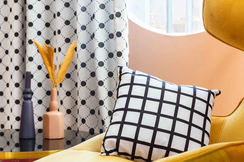 Black and white curtain pillow window