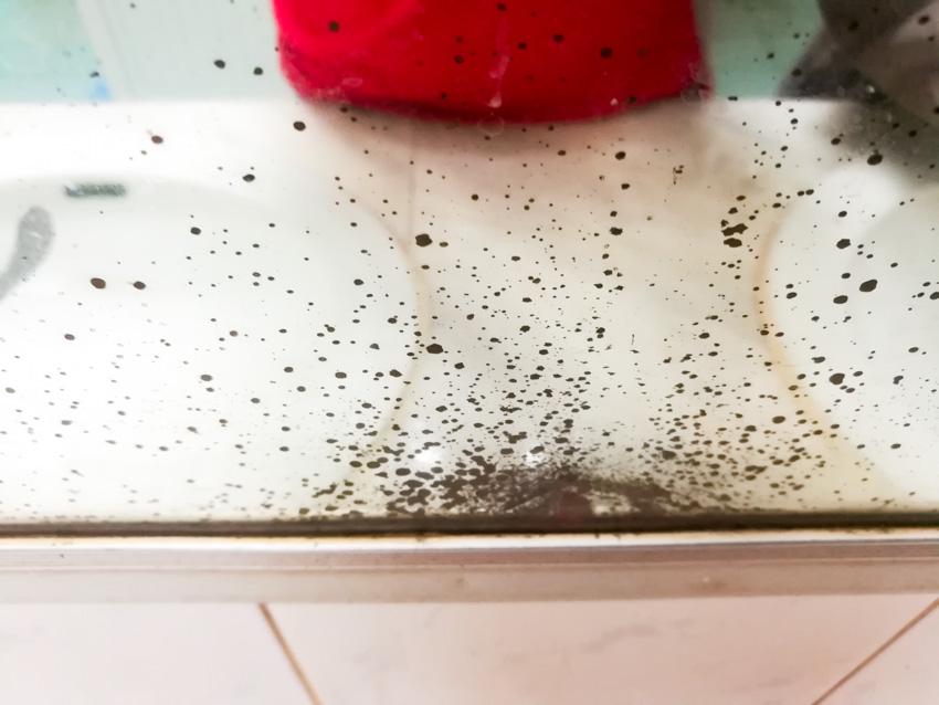 Black spots on mirror