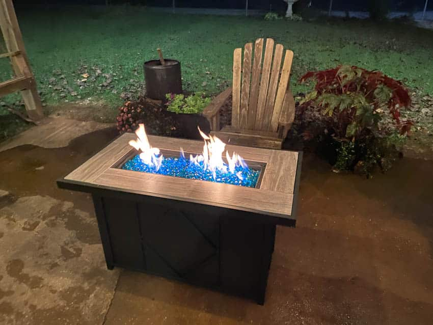 Blue fire glass burning in pit