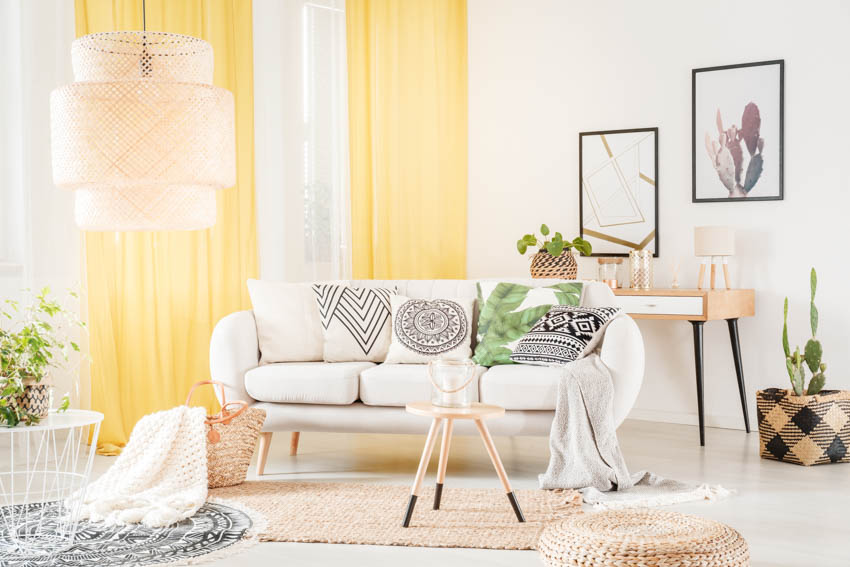 Bohemian yellow living room with rug white sofa indoor plant hanging light