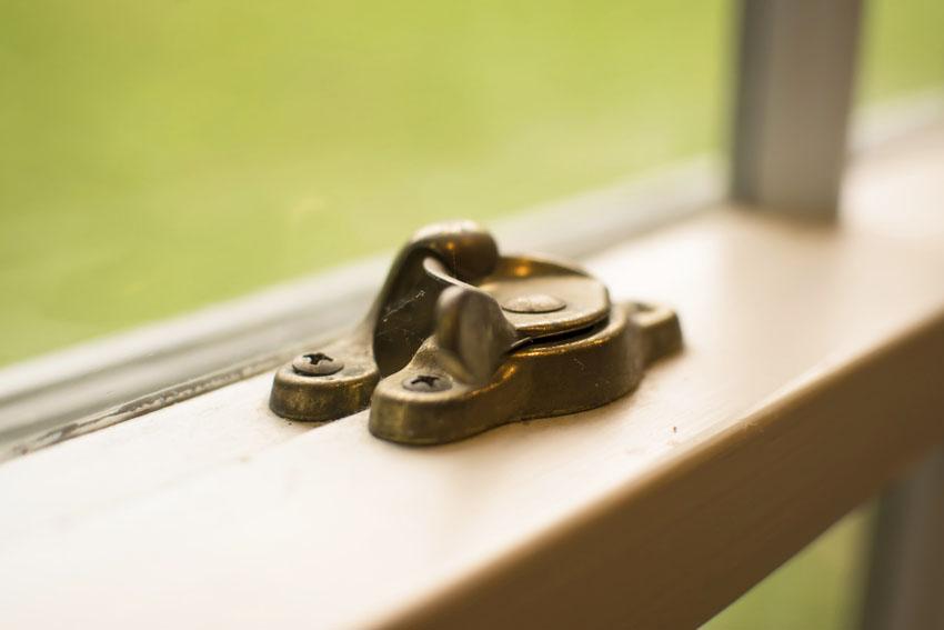 Brass thumb window lock