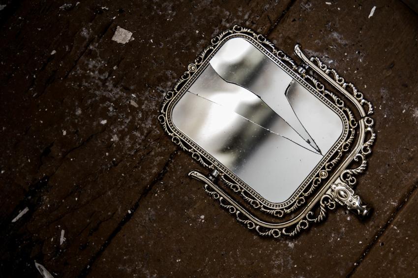Broken mirror on wood floor