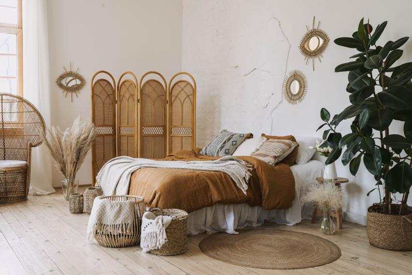 Brown bohemian bedroom indoor plants, wood floor and brown bamboo room divider