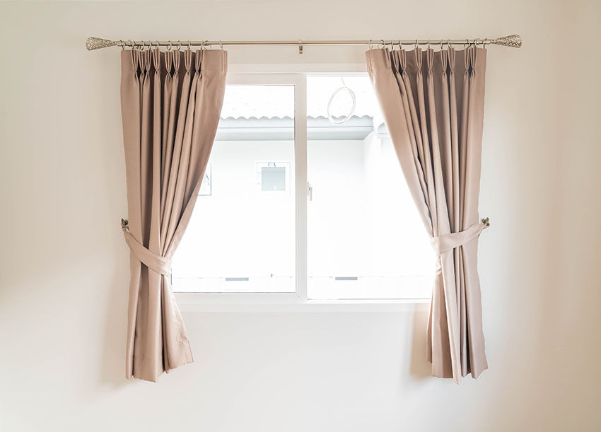 Brown curtain with metal rod