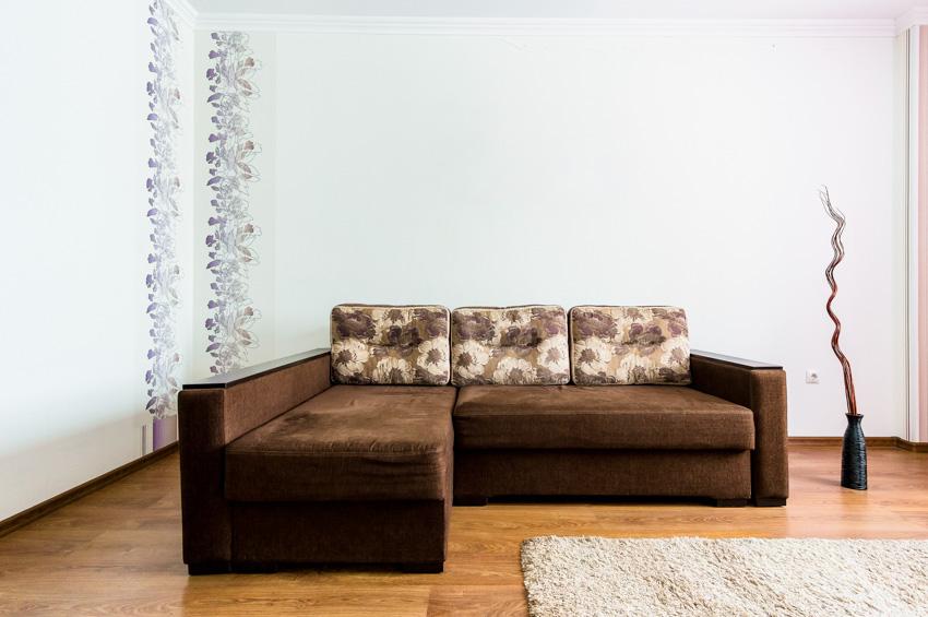 Brown L shaped sofa wood floor