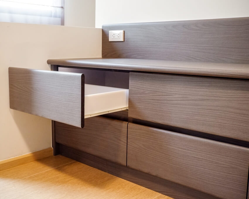 A brown laminate dresser