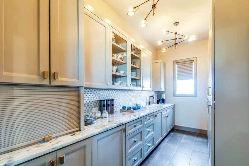 Butler pantry and laundry room with elegant light fixtures
