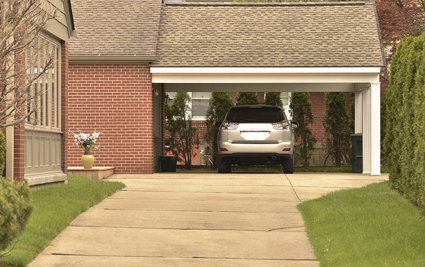 Carport attached to house with parked car