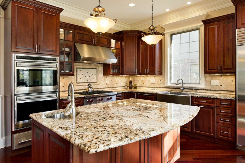 Cherry wood cabinetry kitchen island marble countertop