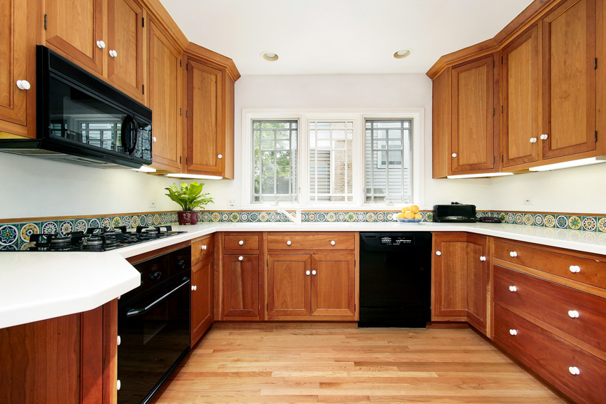 Cherry wood cabinets and drawers in kitchen