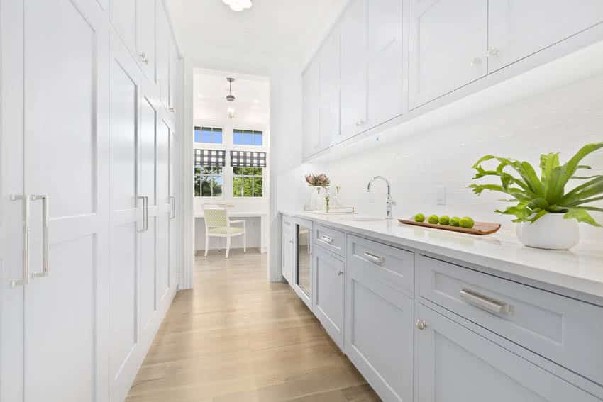 Classic white butlers pantry interior with wood flooring
