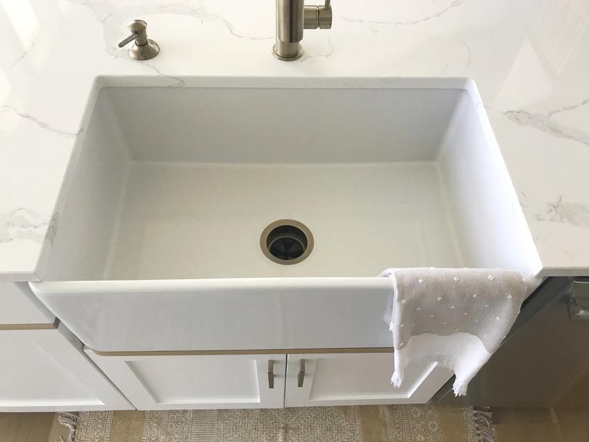 Close up of a quartz fireclay sink