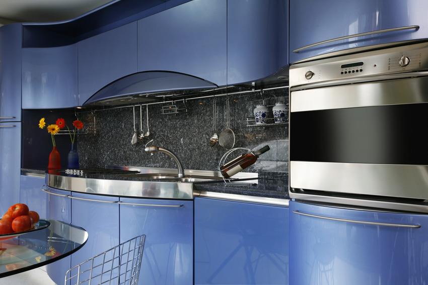Close up of blue elegant and glossy acrylic kitchen cabinets