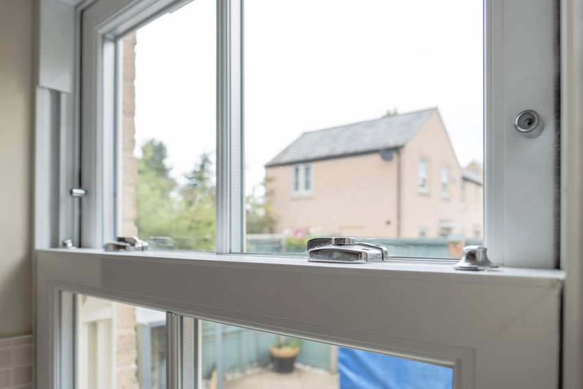 Close up of double hung window with lock