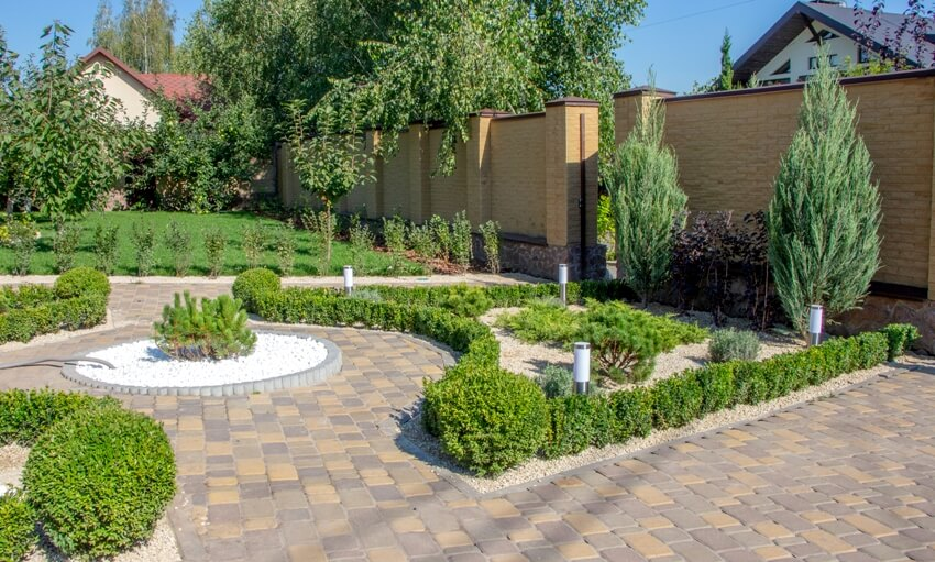 Cobbled concrete paving slab track in a beautifully landscaped garden