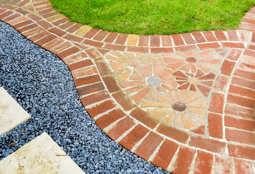 Complex brick pattern with gravel walkway