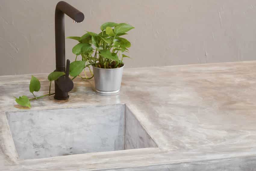 Concrete countertop with sink and faucet