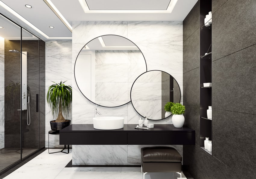 Contemporary bathroom with round mirrors concrete gray wall countertop sink indoor plants
