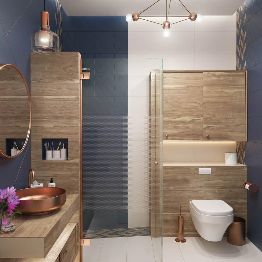 Copper sink on wood countertop toilet blue walls bathroom