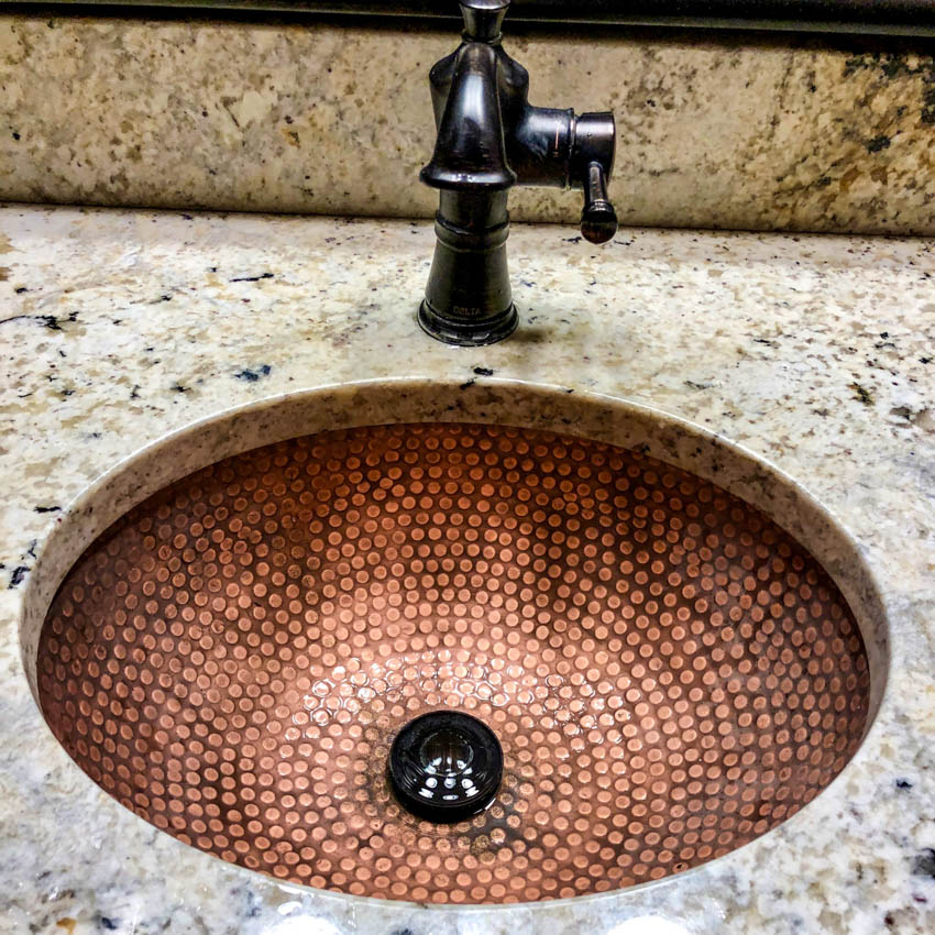 Copper sink with pattern marble countertop black faucet