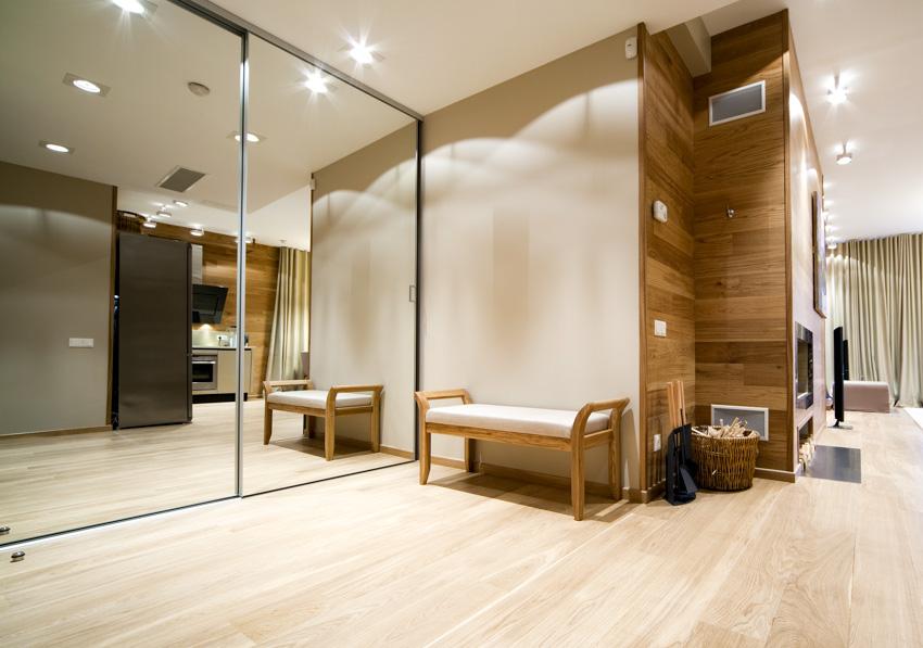 Corridor mirror on wall wood floor