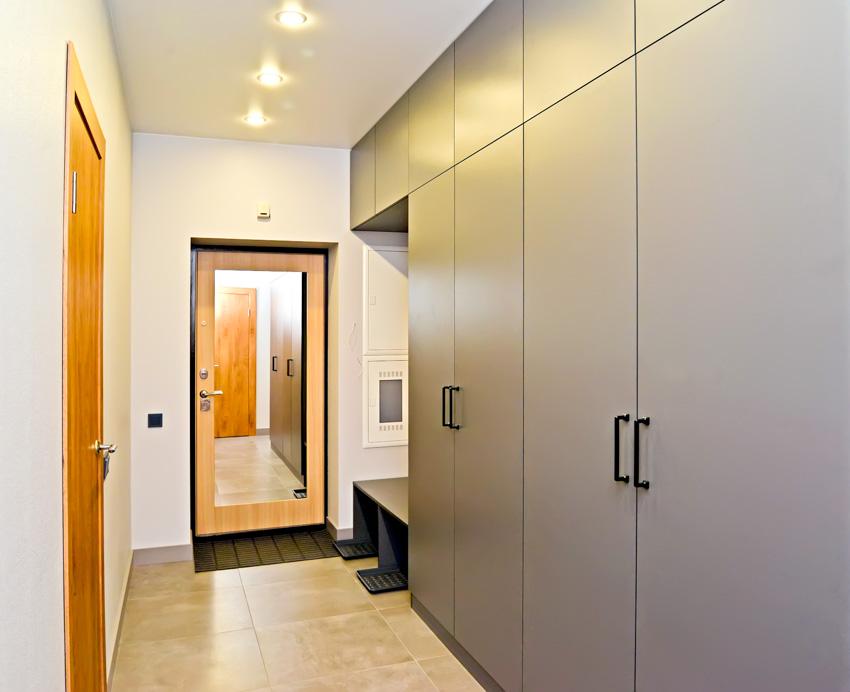 Corridor cabinets mirror behind door recessed lights