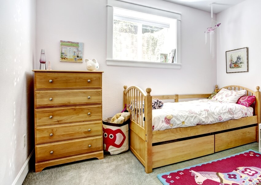Cozy kids room with rustic bed and dresser