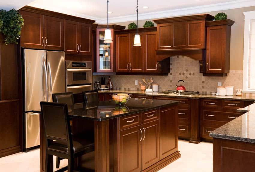 Dark maple cabinets black granite countertop