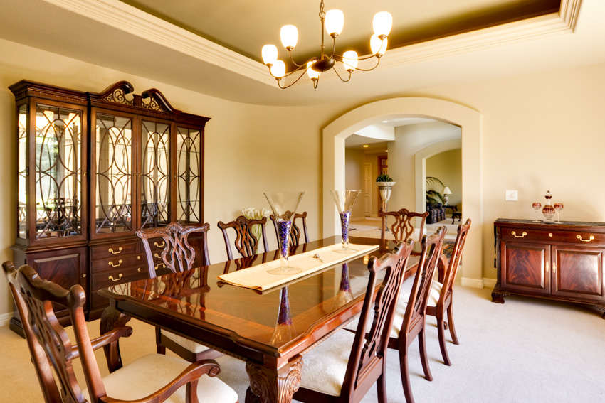 Dining room cherry wood chairs table cabinets drawers chandeliers