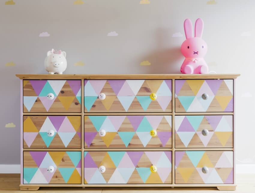 DIY colorful patterned dresser with toys in pastel girl room