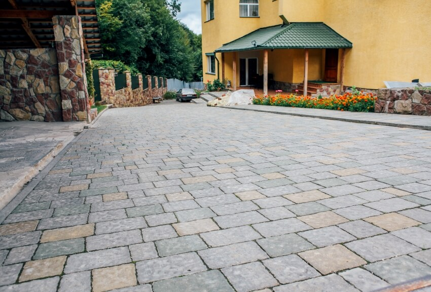 Driveway pavers in vintage design flooring square pattern texture on the ground of street road