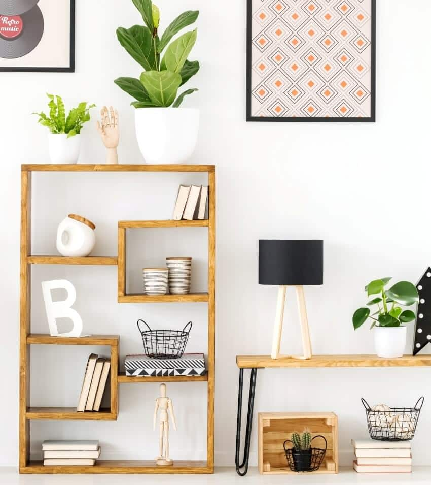 Engineered wood shelf with ornaments in a living room with posters on a wall