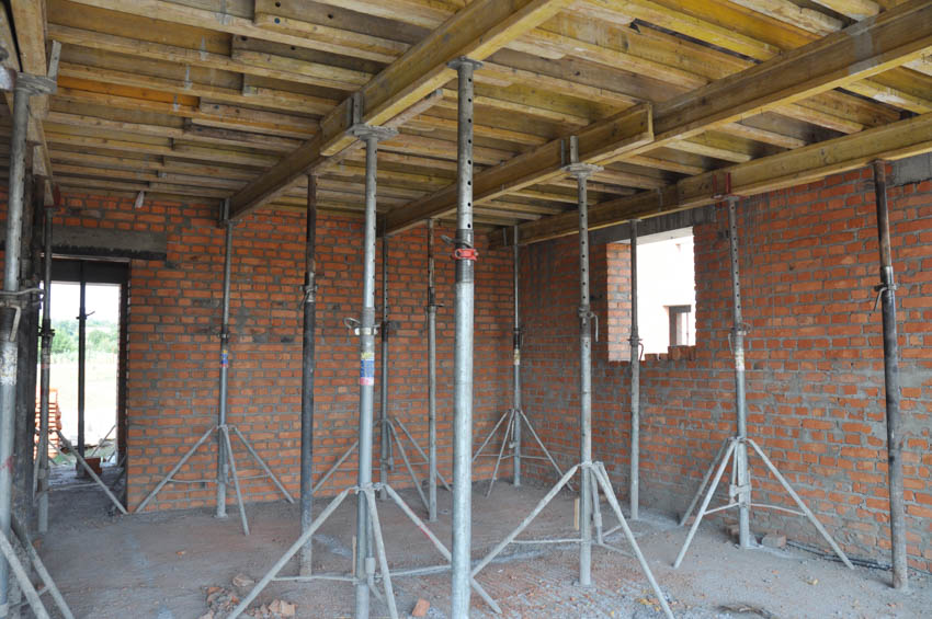 Exposed garage ceiling brick wall construction for bathroom