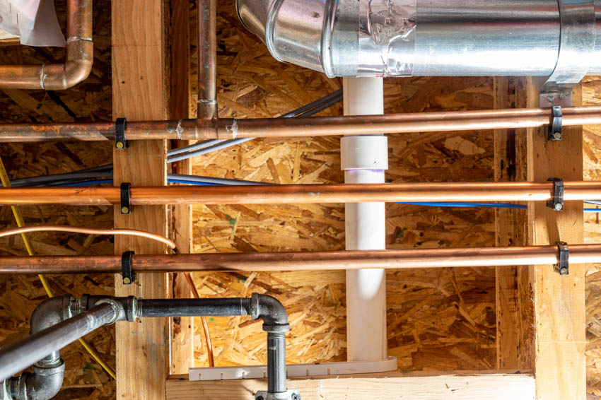 Exposed plumbing and electrical pipes garage ceiling