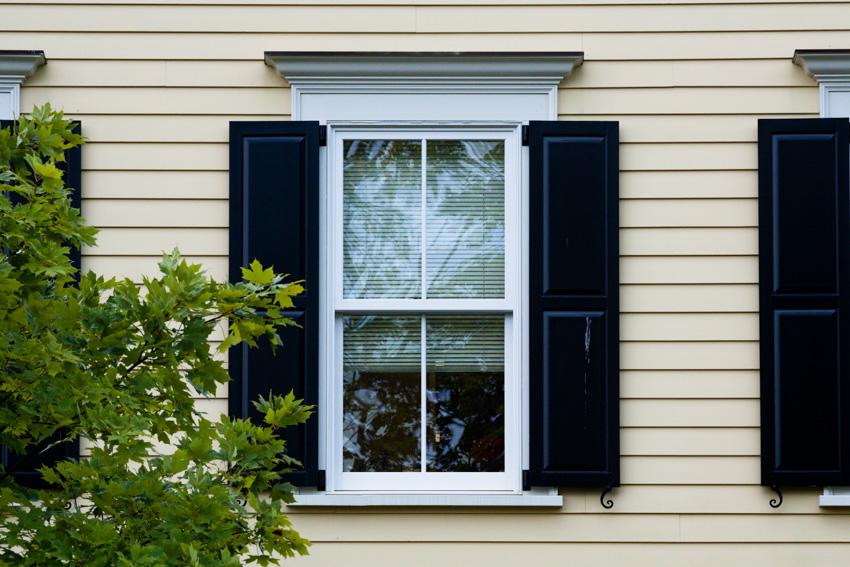 Exterior panel shutters glass window