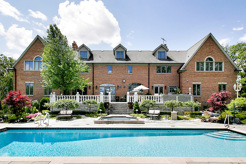 Faux stone skirting deck pool mansion