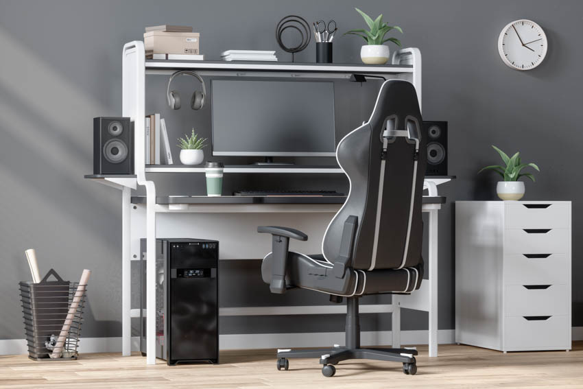 Gaming station with chair wood floor white drawer