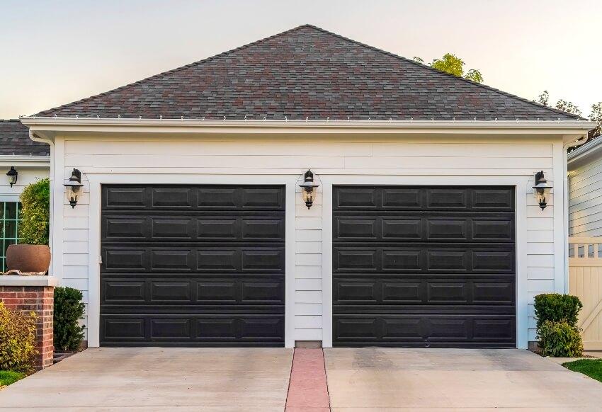 Garage with black paint metal double door and short driveway
