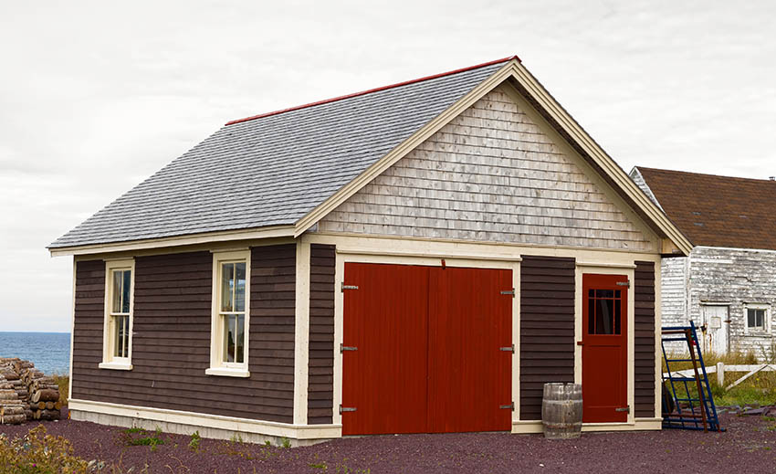 Garage with composite shingle roofing