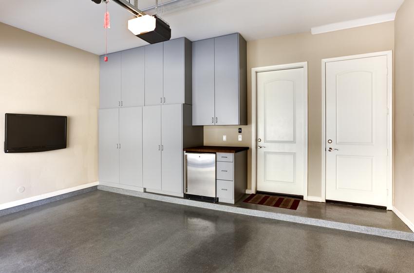 Garage with custom gray cabinets